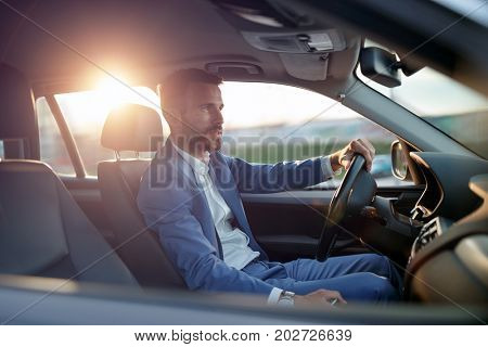 Businessman manager traveling in car