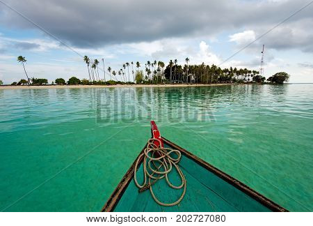 Boat heading toward Sibuan Island located in Semporna in the vicinity of Sipidan Island and Tun Sakaran Marine Park Sabah Borneo Malaysia.