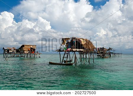 Semporna, Malaysia - 19 April, 2015: A Bajau Floating Village Of Stilted Houses Off The Coast Of Bor