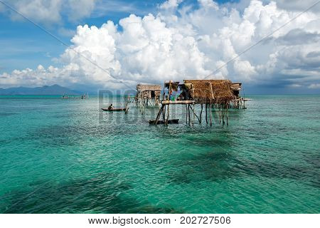 A Bajau Laut Floating Village Of Stilted Houses Off The Coast Of Borneo In The Celebes Sea In The Vi
