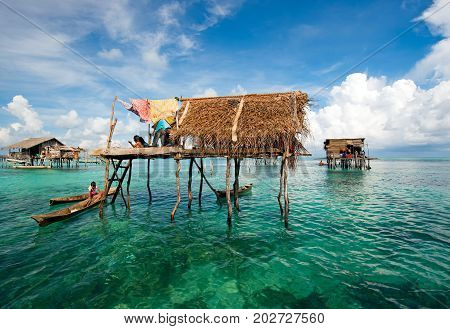 Semporna, Malaysia - 19 April, 2015: A Bajau Laut Floating Village Of Stilted Houses Off The Coast O
