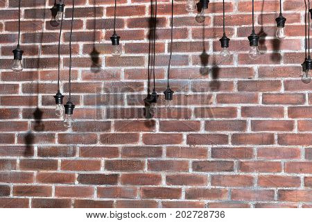 Brick wall with bulb lights lamp. nice brick show room with spotlights