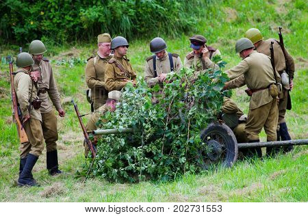 Soldiers with artillery.The VIII International Festival of Military History and remake for the battle `1944` 6.08.2016 in Valga, Estonia
