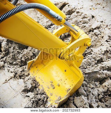 bucket of the tractor or excavator digging sand