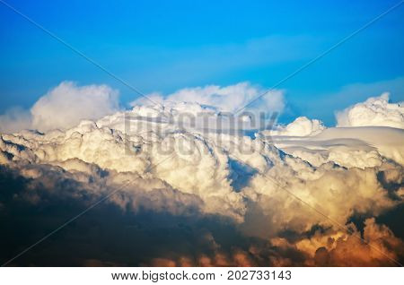 Cumulus clouds in the blue sky after a thunderstorm. Beautiful natural landscape