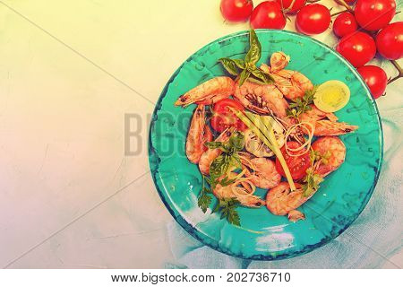 Bbq Grilled Shrimps On Blue Plate Serving With Cherry Tomato, Parsley, Basil, Leek And Baked Garlic.