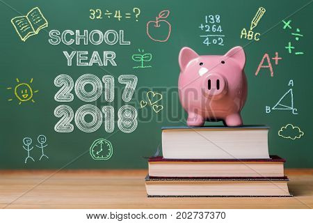 School year 2017-2018 with pink piggy bank infront of a chalkboard