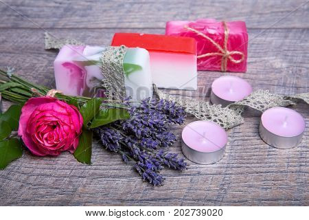 Handmade Soap with bath and spa accessories. Dried lavender and nostalgic pink rose. Spa background
