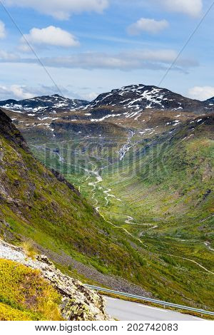 Road, river and mountain beautiful landscape in Norway