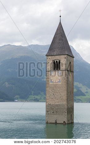 Submerged Tower Of Reschensee Church Deep In Resias Lake In Trentino-alto Valley