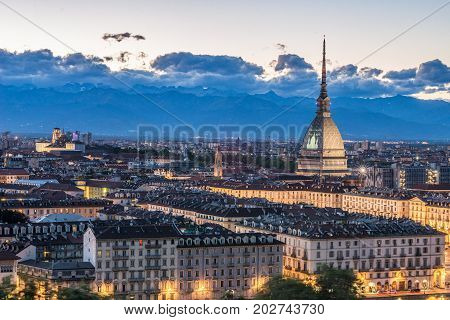 Torino Cityscape, Italia. Skyline Panoramic View Of Turin, Italy, At Dusk With Glowing City Lights.