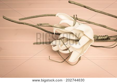 Elegant spring flower fake gardenia on rustic wooden table. For wedding background image.