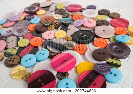 Set of different colored buttons on white background. Top of view