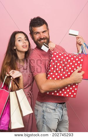 Guy With Beard And Lady Do Shopping. Couple In Love