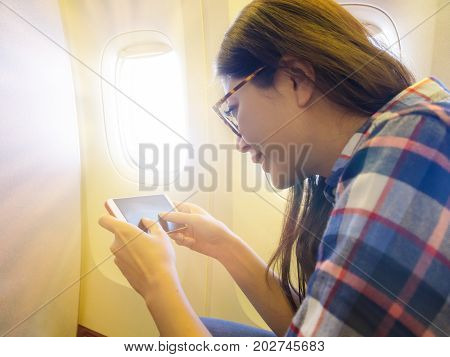 Smiling Female Passenger Sitting Near Window Seat