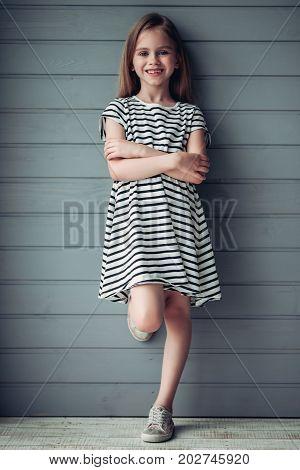 Cute Little Girl On Grey Background