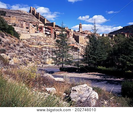 View of the town and church spire with castle wall to the rear Albarracin Teruel Province Aragon Spain Western Europe.