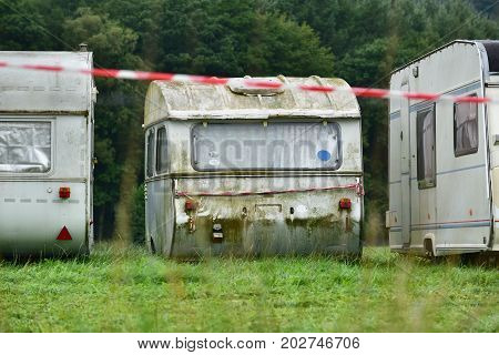 Decrepit caravan on a travel trailer parking in the Belgian Ardennes.