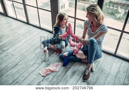 Mom With Daughter Doing Cleaning