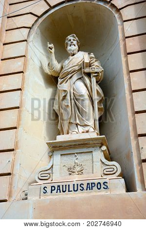Statue of St Paul in an alcove on the front of the Parish church of our lady of sorrows Bugibba Malta Europe.