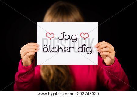 Child Holding Sign With Swedish Words Jag Alsker Dig - I Love You