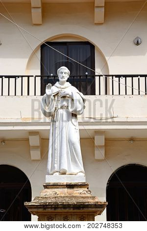 Monk statue outside the Parish church of our lady of sorrows Bugibba Malta Europe.