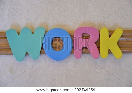WORD WORK ON A  ABSTRACT  COLORFUL BACKGROUND