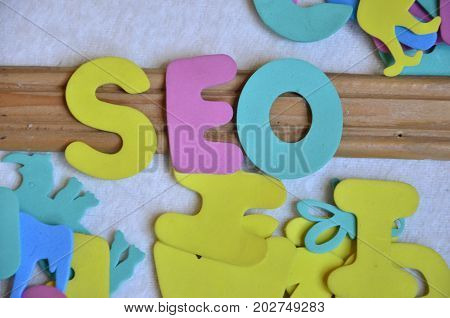 WORD SEO ON A  ABSTRACT COLORFUL BACKGROUND