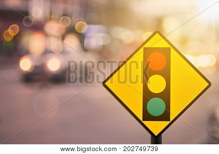 Traffic Light Warning Sign On Blur Traffic Road With Colorful Bokeh Light Abstract Background.