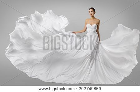 Woman White Dress Fashion Model in Long Silk Gown Waving Flying Fabric Fluttering on Wind