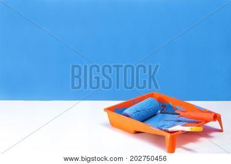 closeup paint roller brush tools work paint blue color