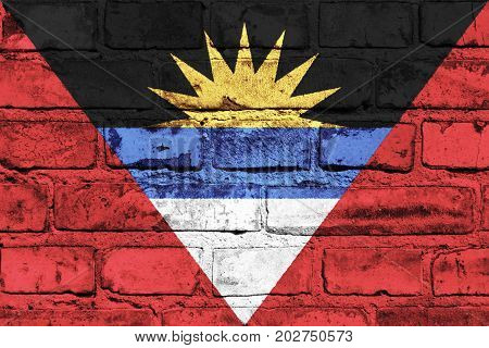 Antigua and Barbuda flag painted on the brick wall