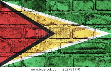 Guyana flag painted on the brick wall