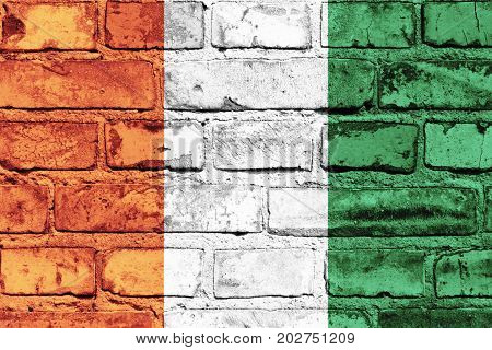 Cote d Ivoire flag painted on the brick wall