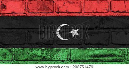 Libya flag painted on the brick wall