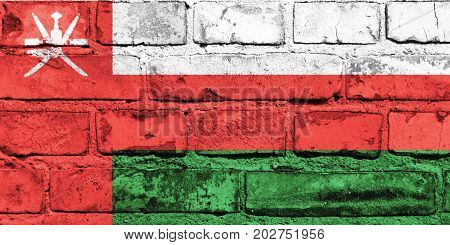 Oman flag painted on the brick wall