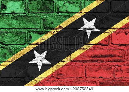 Saint Kitts and Nevis flag painted on the brick wall