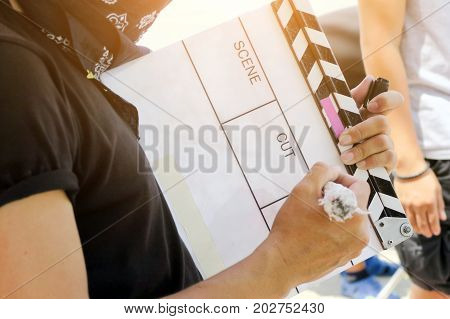 Film Slate, close up image of film production crew holding Film Slate on set