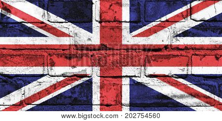 The United Kingdom flag painted on the brick wall