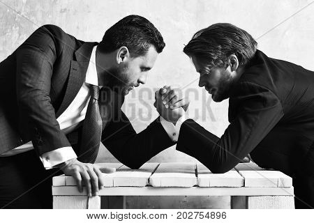 Boss And Employee Arm Wrestling In Office