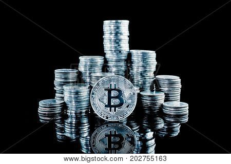 Pile of stacking coins with silver bitcoin on top king of all coins most valuable coin rising currency concept