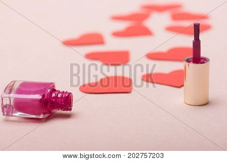 Nail Polish And Lots Of Paper Hearts Making Path