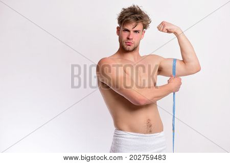 Guy With Towel And Flexible Ruler Isolated On White Background