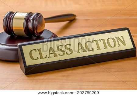 A Gavel And A Name Plate With The Engraving Class Action