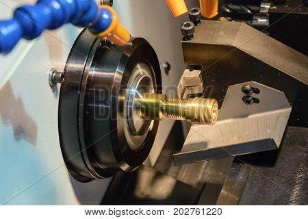 CNC lathe machine or Turning machine cutting the copper part .Hi technology manufacturing