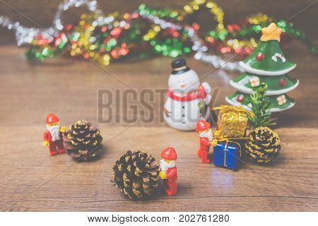 Lego Santa Claus Minifigure With Christmas Scene On Wooden Background