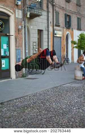 Ferrara, Italia - August 23, 2017: The Ferrara Buskers Festival is dedicated to the art of the street. The artist performs a deadly leap backwards in the street. Soldiers Crew