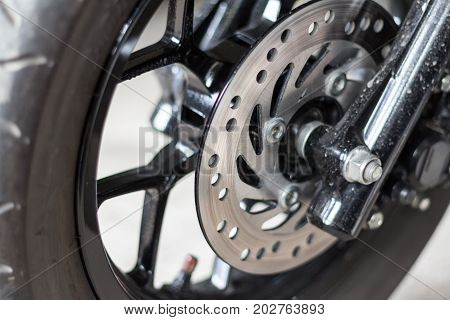 Motorcycle wheel disc brake background in modern scooter bike