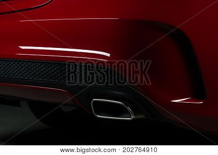 Car detailing series: Closeup of red car exhaust pipe