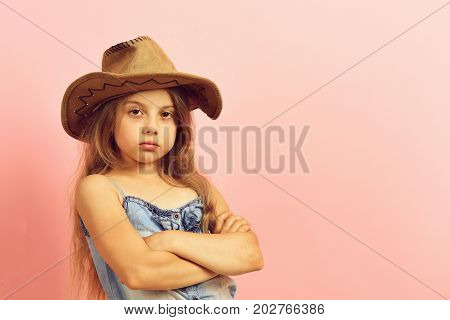 Kid With Confident Face And Fair Hair Wears Jeans Dress